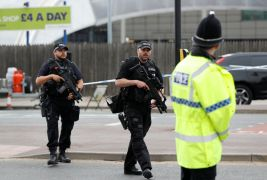 Armed police stand near the Manchester Arena in Manchester